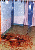 Private interview room doors with blood on floor after murders