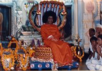 Sathya Sai Baba posing as Narayana on the Serpent Bed