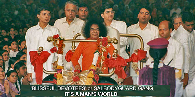 Sathya Sai Baba on his invalid golden 'buggy chair' surrounded by male bodyguards
