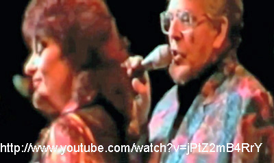 Dana Gillespie and Rolf Harris perform devotional song to the 'one god'